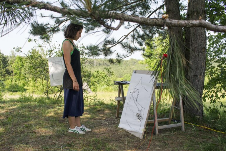 erika glionna looking at duet canvas in the wood